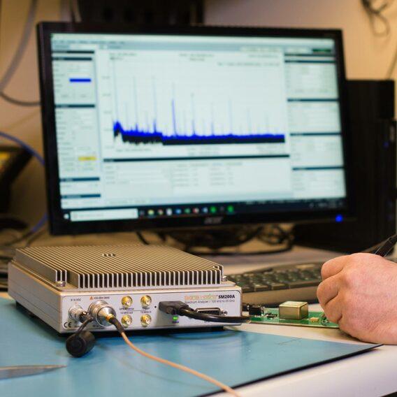 the SM200A spectrum analyzer on a RF work bench